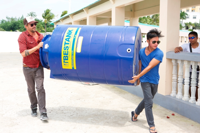 Jon Rose Carries Container in Philippines w: Carlo Delantar