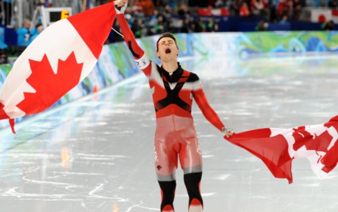 Canada's Lucas Makowsky celebrates after winning gold in the men's speed skating team pursuit DIMITAR DILKOFF : AFP:GETTY IMAGES